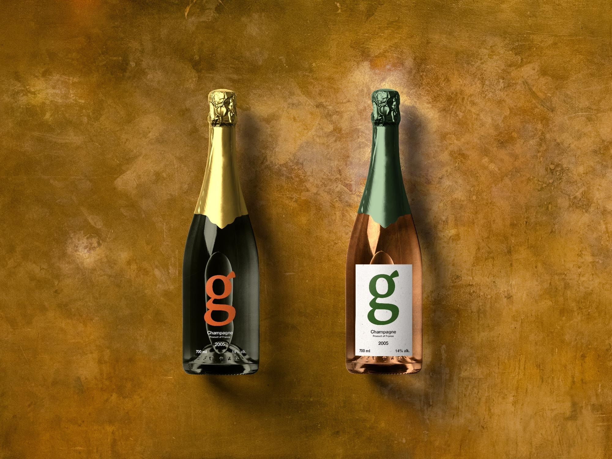 Two champagne bottles on a brass background